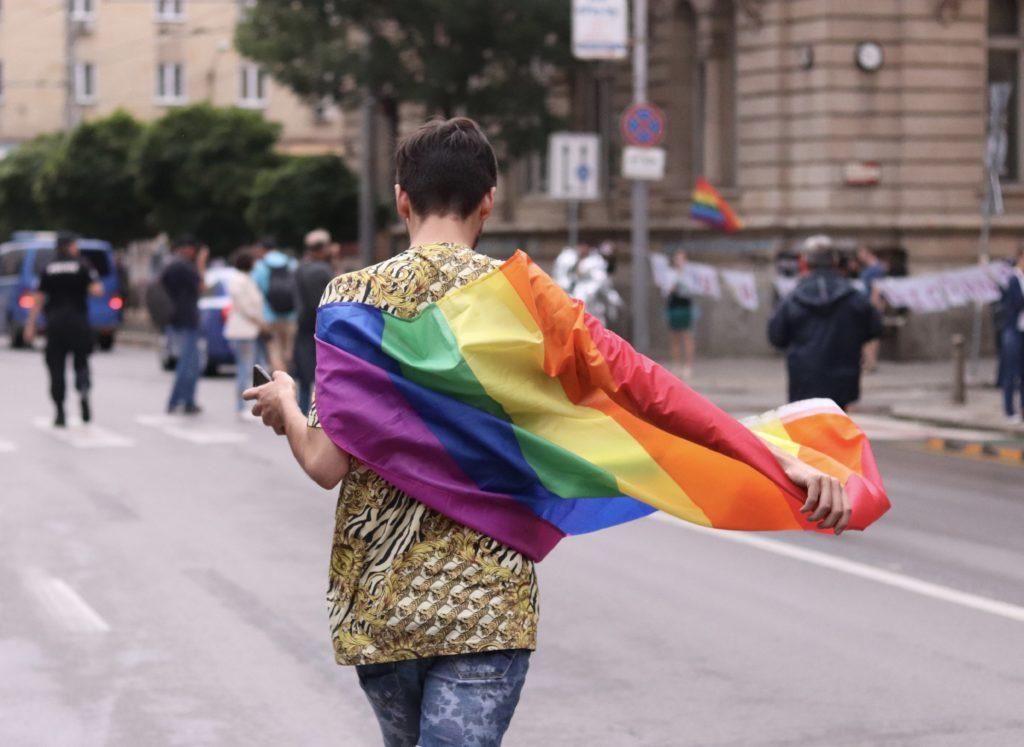 pride flag walking on street